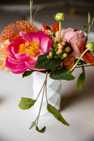 Coral Charm Peony and Protea Centerpiece. Lubbock wedding florist Jessica Ormond Events. Photo credit - Caitlin & Ryan Photography.