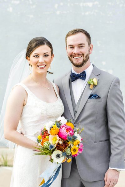 Bride and Groom with colorful bouquet