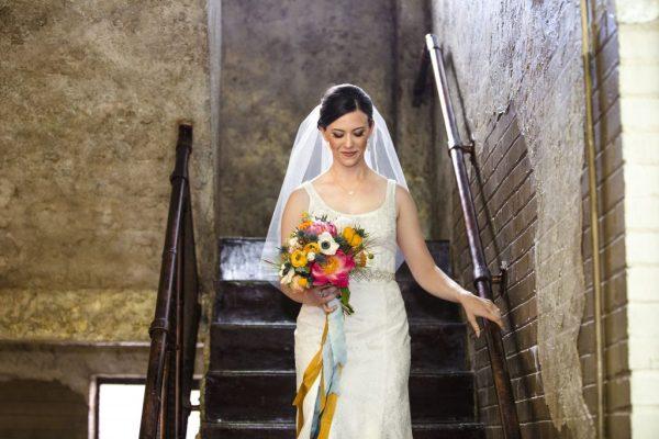 Bride descending stairs for ceremony. Lubbock Wedding Coordinator Jessica Ormond Events. Wedding photographer - Caitlin & Ryan Photography.