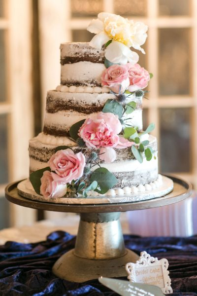 Semi-naked cake with pink roses by The Cakery Lubbock. Planner Jessica Ormond Events. Photographer Allee J