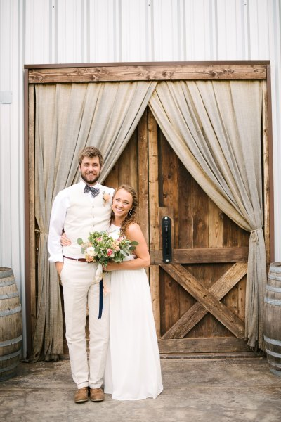 Midland Bride and Groom with a casual summer wedding at Cotton Creek Barn, TX. Flowers designed by Jessica Ormond Events. Picture by Amanda Scott Photograhy.