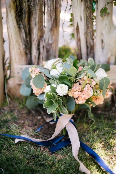 Fresh coral, peach, and white summer bridal bouquet of garden roses, Ranunculus, Scabious, Stock designed by Texas wedding florist Jessica Ormond Events. Picture by Amanda Scott Photograhy.