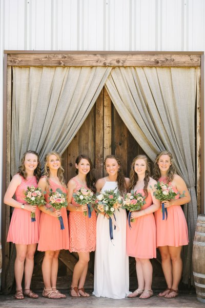 Midland bride and bridesmaids with garden bouquets at Cotton Creek Barn, Texas. Bouquets designed by Jessica Ormond Events. Picture by Amanda Scott Photograhy.