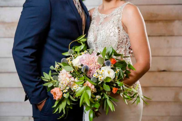 Wild and glamours cafe latte dahlia bouquet designed by Texas wedding florist Jessica Ormond Events. Caitlin and Ryan Photography.
