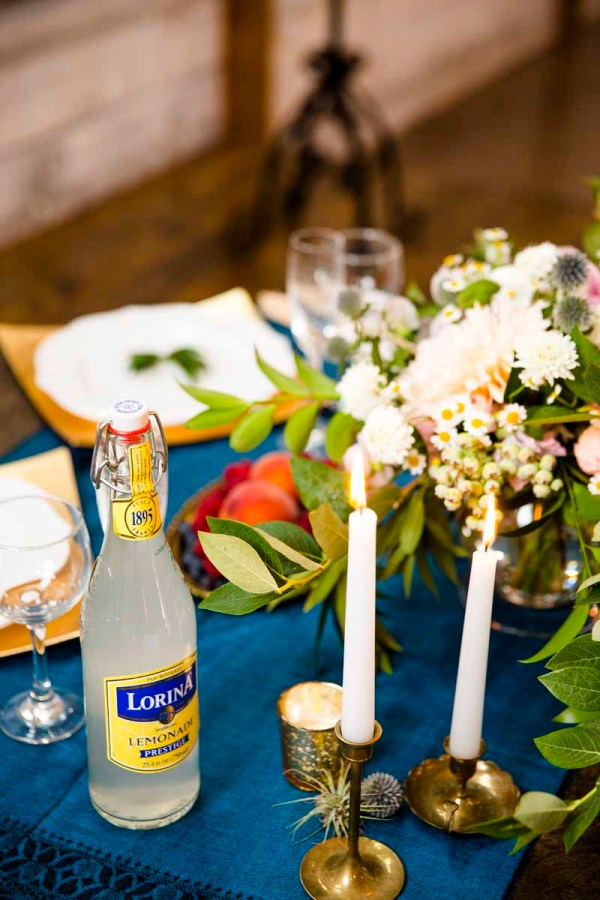 Sweet heart table with blue scarf, candles, and centerpiece at Eberley Brooks Events in Lubbock Texas. Designed by wedding florist Jessica Ormond Events. Photography by Caitlin and Ryan Photography.
