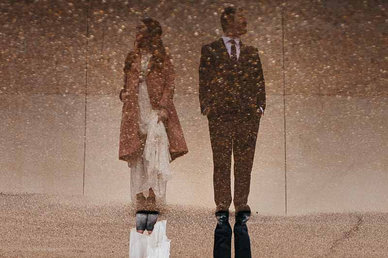 Bride and Groom reflected in puddle. Texas wedding photographer, Photo by Betsy. Wedding planner Jessica Ormond Events.
