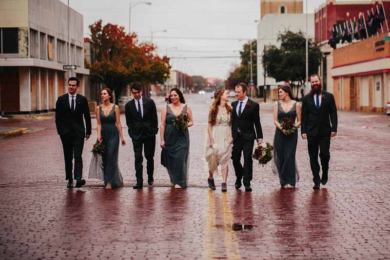 Wedding party on rainy downtown streets. Photo by Betsy. Lubbock wedding planner Jessica Ormond.