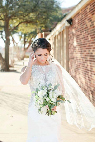 Elegant bride with white bouquet at the Legacy Event Center in Lubbock Texas. Floral design by Jessica Ormond Events. Tara Hobgood Photography.