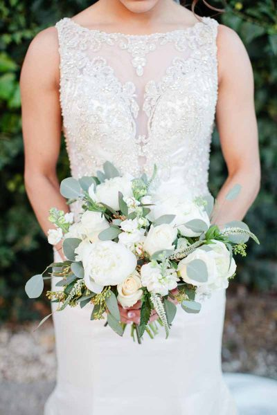 Lush white bridal bouquet of peonies, roses, and veronica. Texas wedding florist Jessica Ormond Events. Lubbock photographer Tara Hobgood Photography.