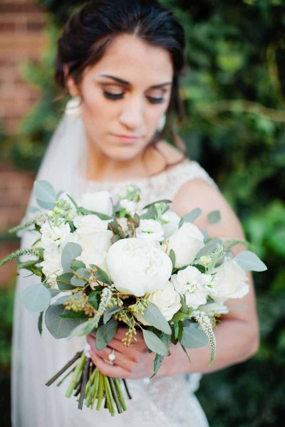 White peony bridal bouquet designed by West Texas wedding florist Jessica Ormond Events. Image by Lubbock photographer Tara Hobgood Photography.
