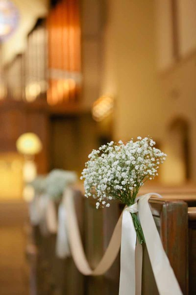 Baby's Breath and ribbon tied aisle for a winter Texas wedding at the Legacy Event Center in Lubbock. Designed by Jessica Ormond Events. Photographed by Tara Hobgood Photography.