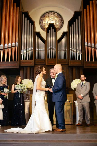 Winter wedding ceremony at Legacy Event Center in Lubbock, Texas. Florist, Jessica Ormond Events. Photogropher, Tara Hobgood.