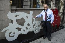 Mexican artist Gilberto Aceves Navarro poses for a portrait with two of his bicycle sculptures in New York June 30, 2014. REUTERS/Lucas Jackson