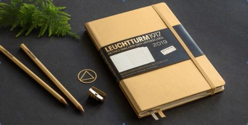 Werbegeschenk goldenes Notizbuch und Kalender von Leuchtturm1917