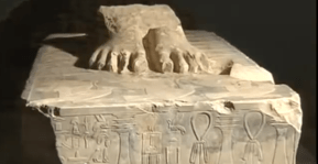 The base of a statue of Djoser with the names and titles of Imhotep in heiroglyphics