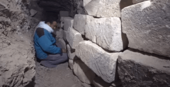 The shaft was cased with limestone blocks which have fallen down and crushed the sarcophagus. The blocks are now neatly stacked in part of the tomb.