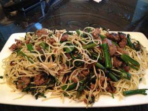 Spaghettini with Italian sausage, broccolini, garlic, basil, and olive oil.
