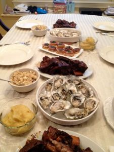 Oysters on the half-shell, port-braised short ribs, pork belly appies, sweet potato mash, and quinoa salad.