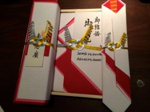 The personalized wedding envelopes Akemi's family prepared for the wedding. is this a subtle hint?