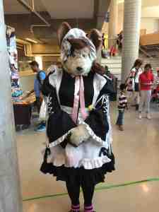Quaint yet creepy mouse person in frock.