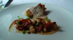 Crispy sweetbread and squid, chorizo, piquillo peppers, pumpkin seeds, and seafood emulsion at Bronte Restaraunt