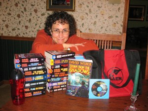 Book of the Month Club participant and Weber swag winner Sparrowhawk settles down to a readeriffic weekend compliments of the gang at Baen.
