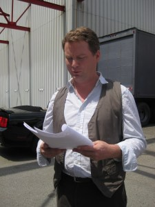 Patrick Gilmore (Volker) checks out the latest script.
