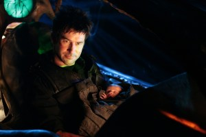 In the script's original draft, Sheppard is alone in the cockpit.  SyFy Exec Chris Sanagustin suggested that, rather than stowing the baby away with the others, our hero should have the infant with him instead.  It was a great idea and offered up one of the episode's more touching moments.  Search and Rescue, Stargate: Atlantis, Season 5 (photo courtesy and copyright MGM Television).