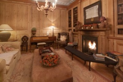The elegant lounge and library of the Pand Hotel are filled with antiques.