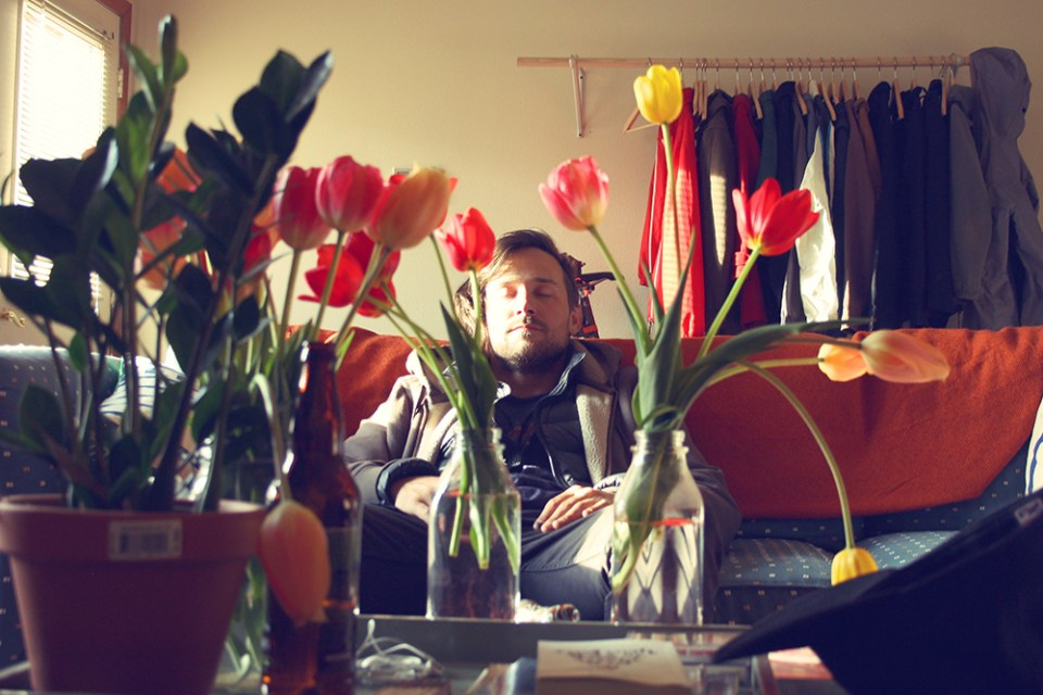 Kivett resting between some tulips. Check out his music by clicking the photo.