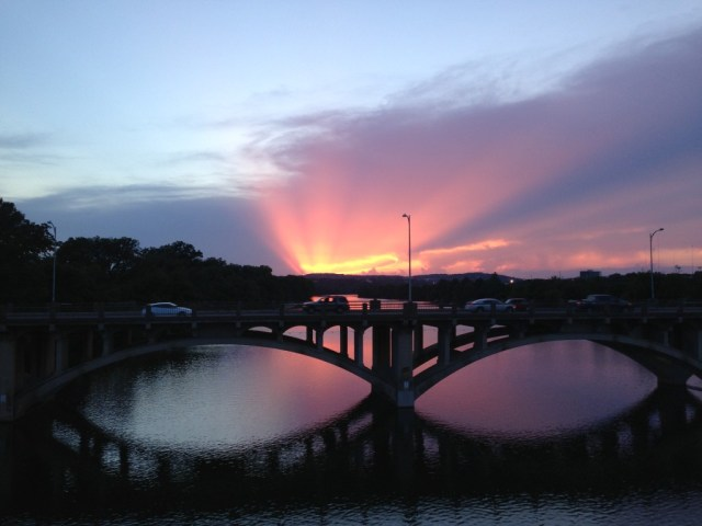 Shot of a bridge on town lake in Austin at sunset