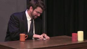 Josh Paget behind the desk of Almost Late Night