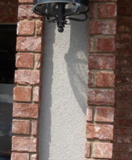 Brick work to accent lamp.