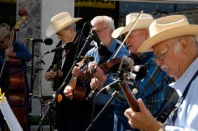 The Dickson County Bluegrass band performs in front of Ragan's Arcade on Main Street in downtown Dickson. The music brough several dancers out onto the street. 2014 Old Timers Day. Photo by Josh Arntz