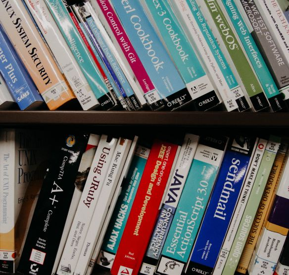various programming books on a shelf