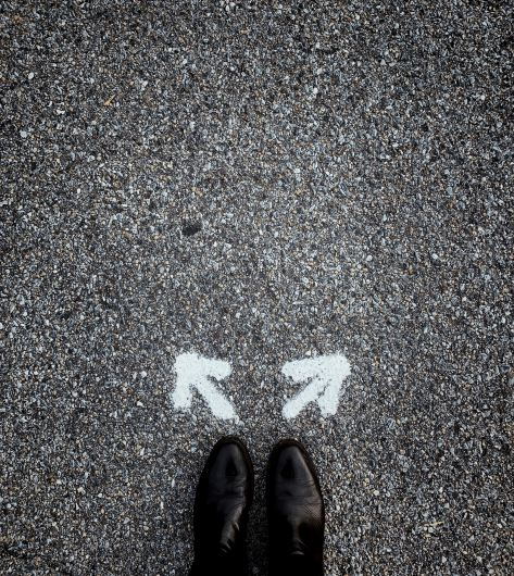 pair-of-feet-in-front-of-two-arrows