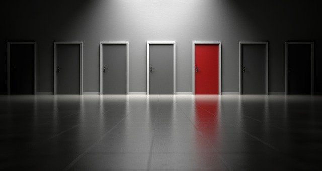image of several doors in a row with one red door