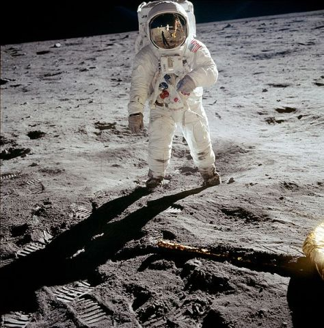 Aldrin poses on the Moon, allowing Armstrong to photograph both of them using the visor's reflection.