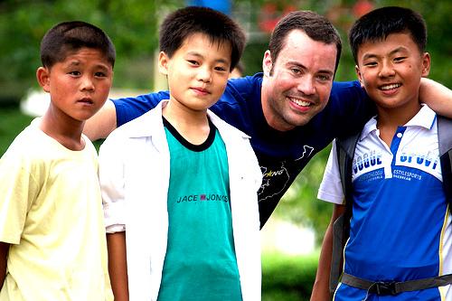 Jordan with kids by frisbee field, Pyongyang, North Korea