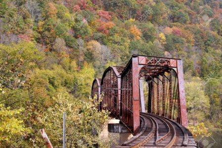13114388-Rural-train-track-in-west-Virginia-mountains-in-autumn-time-Stock-Photo