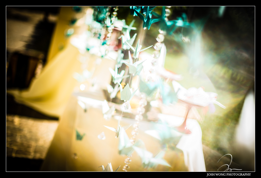 Wedding ideas. The bride folded 1000 origami japanese cranes to decorate area of the ceremony and reception. Wedding pictures by Bay Area wedding photographer Josh Wong