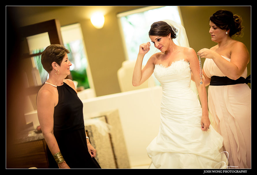 A touching moment with Mom and daughter. Destination Wedding at Grand Velas Resort in Playa Del Carmen, Mexico. Wedding Pictures and photos by top destination wedding photographer Josh Wong Photography