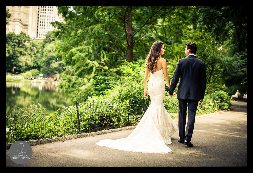 The bride and the groom take a stroll through central park.  Wedding Pictures and photos provided by Josh Wong Photography, New York City