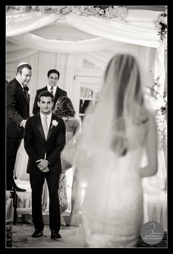 The groom watching the bride walking down the aisle. JW Marriott Essex House Wedding. Wedding Pictures and photos provided by Josh Wong Photography, New York City