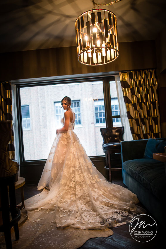 The bride dons on hew gorgeous Monique Lhuillier wedding dress. The Roxy Hotel NY