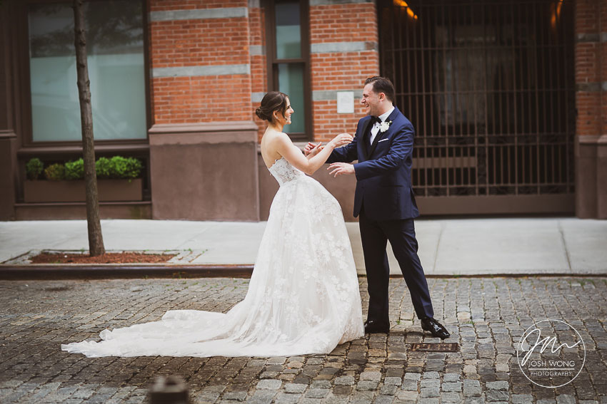 First Look with cobblestone streets
