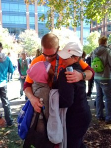 Embracing my family after the finish