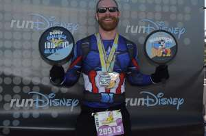 Josh Zeigler in a finisher photo at the 2018 Disney World Marathon
