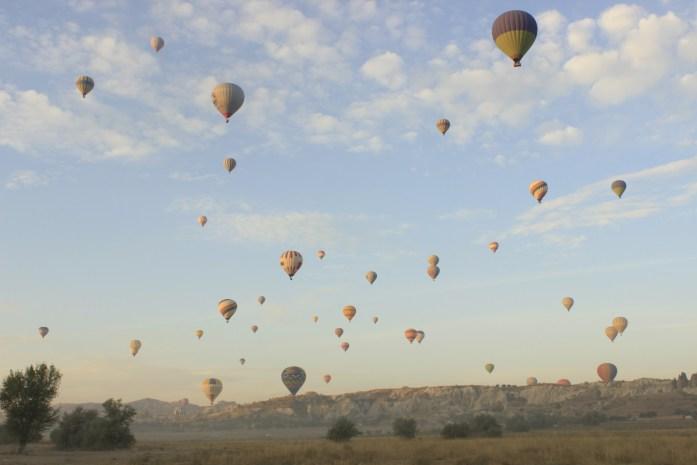 Sunrise at Cappadocia, hot air balloons over Cavusin.
