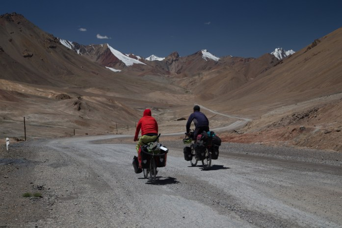 Cycling on the barren Pamir Plateau on the Pamir Highway